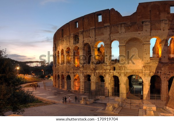 View of the famous Colosseum in Rome, Italy at sunset time.
