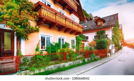 view of famous Hallstatt mountain village with Hallstatter lake.Typical Austrian Alpine houses with bright flowers. Location: resort village Hallstatt, Salzkammergut region, Austria, Alps. Europe.