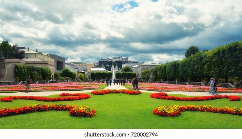 View of famous Mirabell Garden with the old historic Fortress Hohensalzburg in the background in Salzburg, Austria