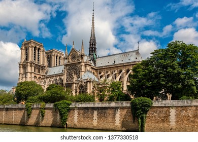 View of famous Notre-Dame cathedral under beautiful sky in Paris, France.