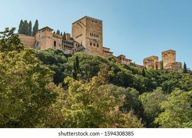 View of the famous palace of Alhambra in Granada, Spain Low angle view of the majestic palace and fortress