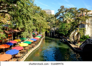 View of the famous River Walk in San Antonio, Texas. The riverwalk is a popular destination for tourists and locals. Sightseeing tours are offered by boats that ply the river day and night.