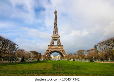 View from a famous spot at Champ de mars public park to see Eiffel Tower; one of the most popular attractions in Paris, France during winter season. Photo by Wide angle lens.