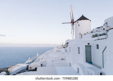 View of famous white buildings of Oia town on cliff in Santorini, Greece