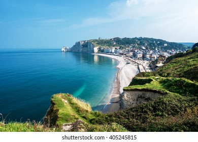 View from the famous white cliffs of Etretat on the beach and the village, Alabaster Coast, Normandy