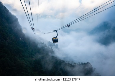 View from Fansipan Cable Car during the rain. Longest non-stop three-rope cable car in the world. Sa Pa, Vietnam.