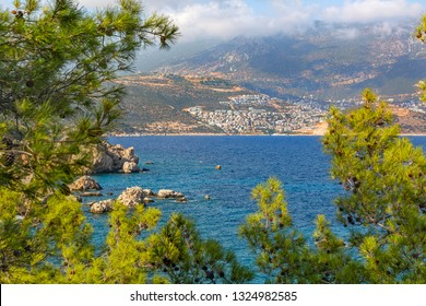 The view of the fascinating Kalkan resort behind Firnaz cove. You can admire this impressive natural beauty in peace. Kalkan is a town in Mediterranean Turkey. Antalya-Turkey
