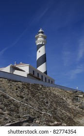 View of Favaritx lighthouse against bright blue sky