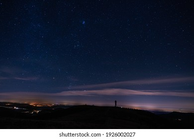 View of the Feldberg tower in the Black Forest in Germany and the starry sky shot in November 2019