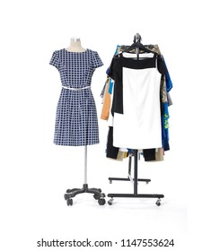 From view female clothes hanging and sundress on mannequin- on clothes rack