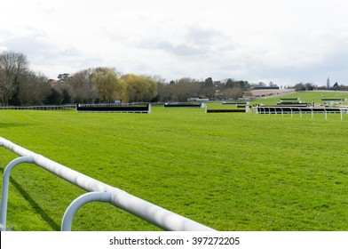 View of fences at Cheltenham Racecourse.