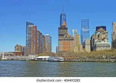 View from Ferry on Pier A in the Hudson River and Battery Park of Lower Manhattan, New York, USA. Tourists nearby