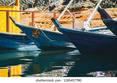 View of fiber boats moored along one of the banks of Royal Banding Lake located in Perak State, Malaysia