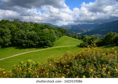 View of field and the mountains of Pico de Europa in El Allende, Asturias, Spain