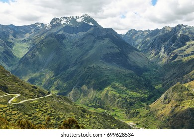 View of fields in the way to Huanuco with Huayhuash range at background, Ancash province, Peru