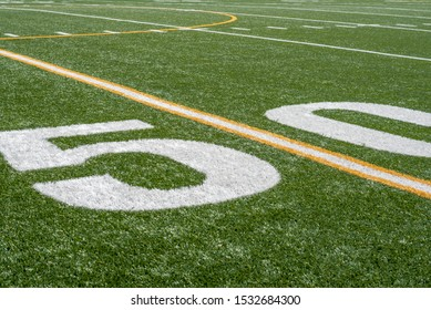 view of fifty yard line on sideline of football field