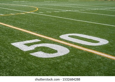 view of fifty yard line from sideline of football field