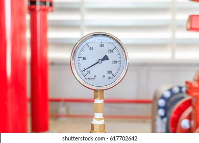 View of fire water pump pressure gauge installed on a red pipe for fire emergency system industry.