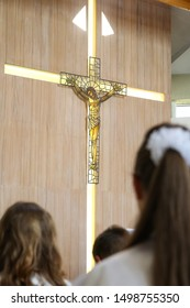 A view of the first holy communion celebration in the catholic church. Children listening to the priest