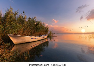 View of fishing boat and lake in the reeds. Bursa, İznik, Van golu, Tuz golu, Turkey.