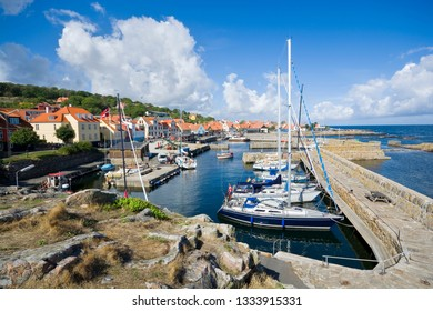 View of fishing boats and yachts moored in the harbor in Gudhjem, Bornholm island, Denmark