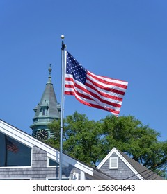 A view of a flag and the town hall spire in Provincetown, Massachusetts