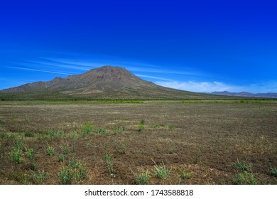 A view of flat area in the Mojave Desert with Bell Mountain near the Town of Apple Valley, California