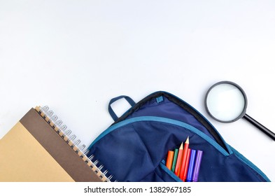 View of flat lay with school backpack and stationery with space for text on white background. Selective focus.
