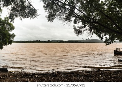 View of flooded Kabini River through the bushes of Kabini forest.