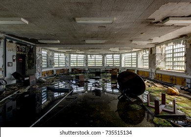 A view of a flooded and reflective room inside the abandoned Hudson River State Hospital in New York.