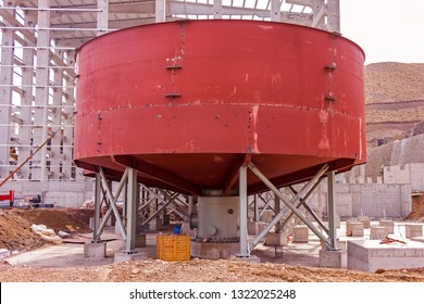 View of the flotation chemical tank (thickener tank) for the mineral separation in the mine plant. Froth flotation is a process for selectively separating hydrophobic materials from hydrophilic.