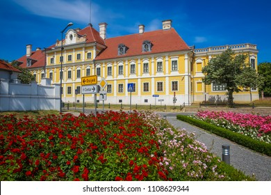 A view of the flowers in park with the City museum located in the Eltz castle in Vukovar, Croatia.