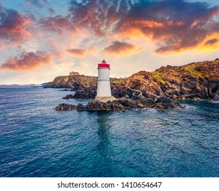 View from flying drone. Exciting morning view of di Capo Ferro Lighthose. Stunning spring sunrise on Sardinia island, Italy, Europe. Colorful Mediterranean seascape. Traveling concept background.