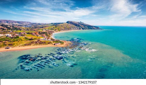 View from flying drone. Incredible morning view of Giallonardo Beach. Fantastic spring seascape of Mediterranean sea, Sicily, Italy, Europe. Traveling concept background.
