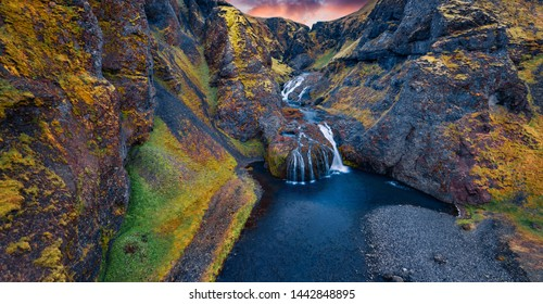 View from flying drone of Stjornarfoss waterfall. Impressive summer sunrise in Iceland, Europe. Beauty of nature concept background. Travel to Iceland.