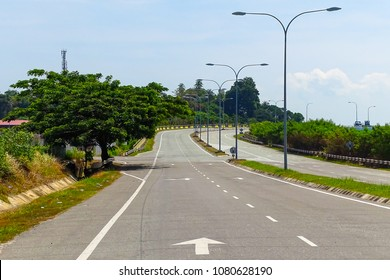 View of flyover the asphalt road highway,green tree &  street light during sunny day in Labuan island,Malaysia.