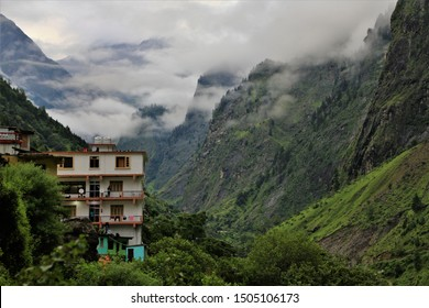 view of fog mountain and building in India,Amazing beauty of Nature. Tarns. Blue sky and white clouds. Wanderlust, hiking, trekking in mountains,Valley of flowers ,on the road,India