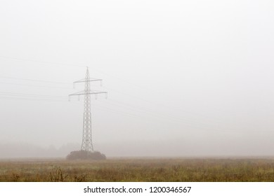 View in the fog over a field on a resting bench