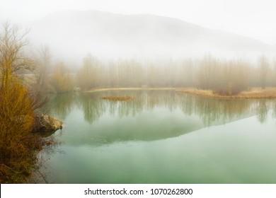 View of Foggy landscape  within Noguera de Tor river, Barruera, Vall de Boi, Lleida, Catalonia, Spain