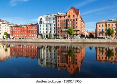 View of Fontanka and profitable houses on the waterfront with their reflection in the water.  Saint Petersburg, Russia