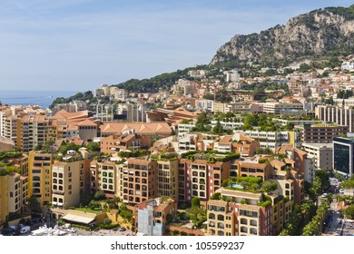 View of Fontvieille - new district of Monaco. Boats and a high-rise apartment complex. Principality of Monaco is a sovereign city state, located on the French Riviera in Western Europe.