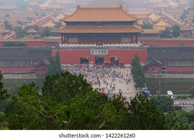 """view of the Forbidden City on The Gate of Divine Might, the northern gate from the hill in smog. The lower tablet reads """"The Palace Museum"""", Beijing China"""
