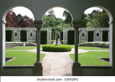 view of formal garden through arched windows