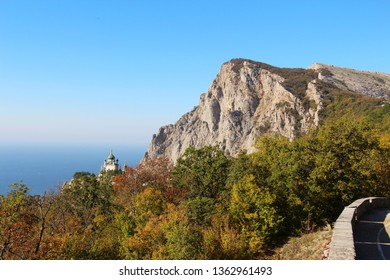 View of Foros Church, also known as The Church of Christ's Resurrection, and Foros Mount from road through the autumn forest. It's a popular tourist attraction on the outskirts of Yalta in the Crimea.