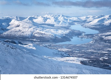 View of Fort WIlliam from the Nevis Range mountains during winter, Scotland.