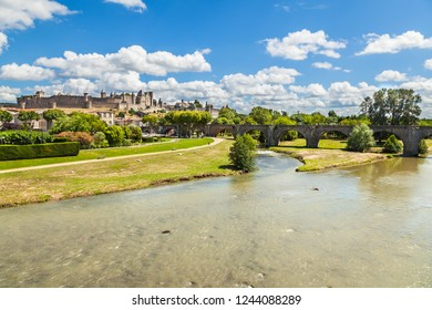 View of fortress Carcassonne, river Aude and Old bridge in France