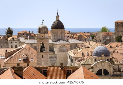 View from fortress Dubrovnik of the medieval city. One can walk around on the ramparts the city. This one has many interesting views on the roofs of old houses and churches with cupolas.