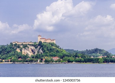 View of the fortress Rocca of Angera, across Lake Maggiore from Arona, Italy.