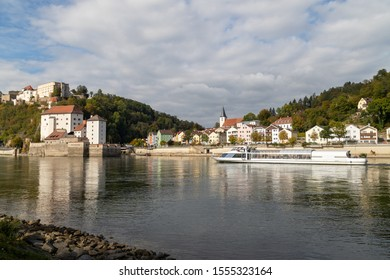 View at Fortress Veste Oberhaus, Danube shore and entry of river Ilz in Passau, Bavaria, Germany in autumn with Danube river and passenger ship