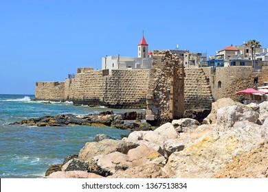 view of the fortress walls and St John's church, old city of Acre, Israel